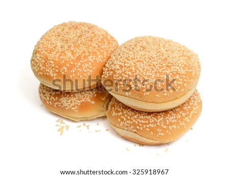 fresh sesame buns isolated on white