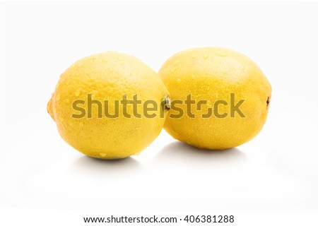 fresh shiny lemons with drops, with shadow, isolated on white background - stock photo