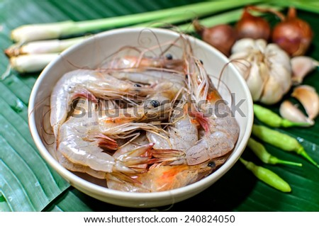 Fresh shrimp with garnish for Tom yam (Spicy Clear Soup, Thai Food) - stock photo