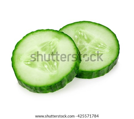 Fresh slice cucumber close-up on a white background. - stock photo