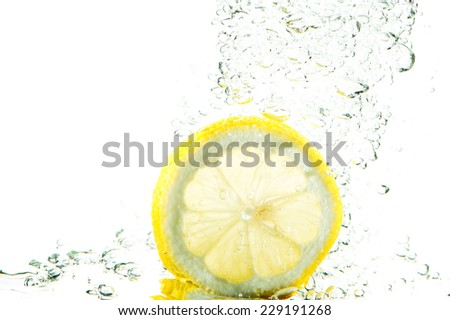 fresh slice of lemon in water splash - stock photo