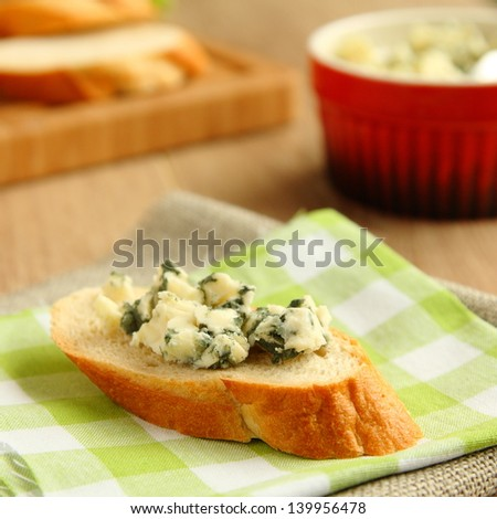 Fresh sliced bread with blue cheese - stock photo