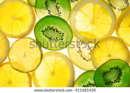Fresh sliced citrus background - stock photo
