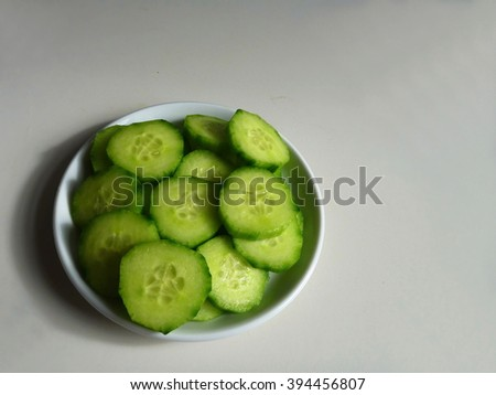fresh sliced cucumber served on a white plate