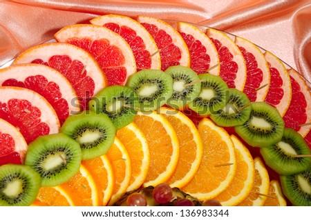 Fresh sliced fruits arrangement - stock photo