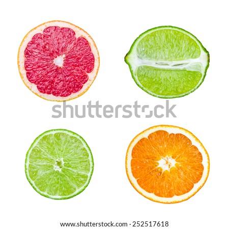 Fresh sliced orange, lime, Grapefruit  fruit isolated on white background - stock photo