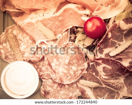 Fresh Sliced raw beef meat with tomato on the table  - stock photo
