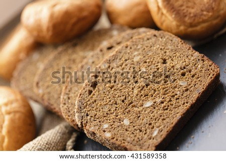 fresh sliced rye bread on a dark background