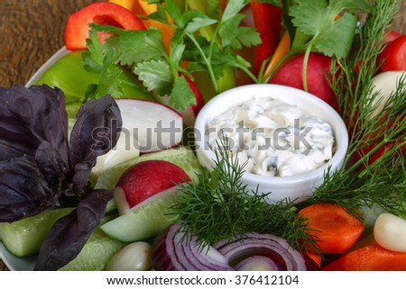 Fresh sliced vegetables with dill, onion, parsley and basil