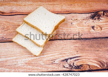 fresh slices of bread on the wooden. DOF and copy space