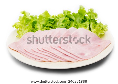 fresh slices of pork ham on plate with green oak - stock photo