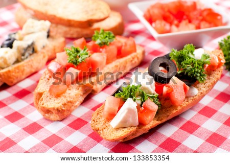 Fresh small sandwiches on the table. Selective focus on the front sandwich - stock photo