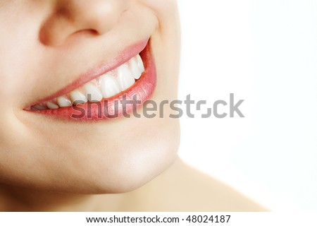 Fresh smile of woman with healthy teeth over white - stock photo