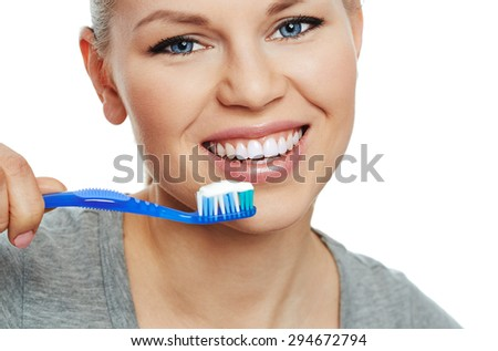 Fresh smile. Oral care woman. Portrait of young Caucasian female brushing her white healthy teeth. - stock photo
