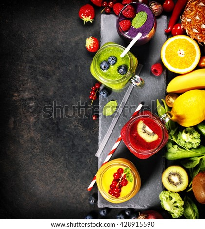 Fresh smoothies and ingredients on rustic background - stock photo