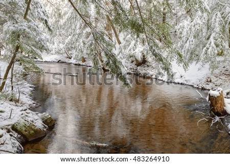 Fresh snow along a winding creek in Marquette, Michigan