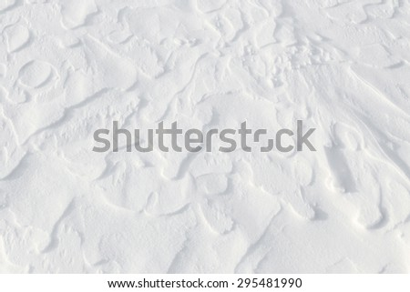 Fresh snow background - windswept, abstract, sculpted, dynamic snow texture