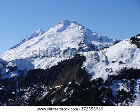 Fresh snow covered Mount Baker on a sunny day - stock photo