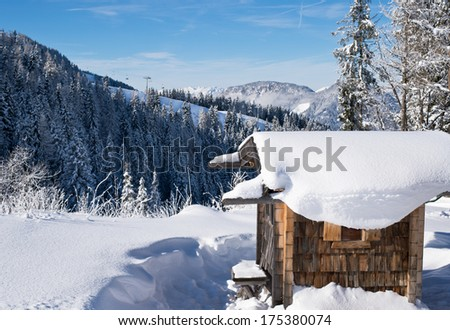 Fresh snow scenery on the slopes of Austrian Alpes. - stock photo