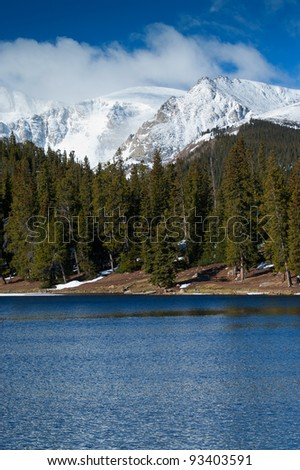 Fresh snowfall covers the peak of Mount Evans above Echo Lake