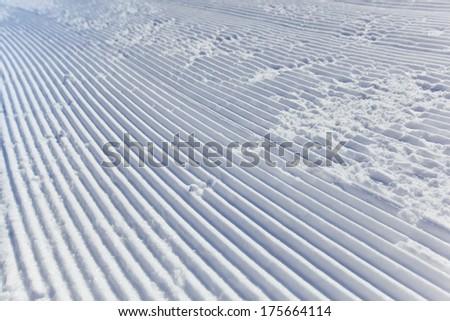 Fresh snowmobile curves - stock photo