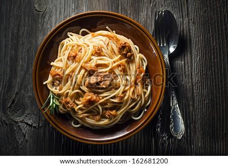 Fresh spaghetti wit tuna sauce overhead shoot - stock photo