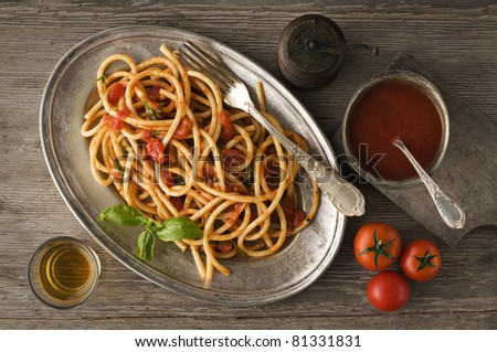 Fresh spaghetti with tomato sauce on a plate close up - stock photo