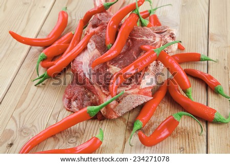 fresh spare ribs : raw lamb with red chili pepper on wooden table - stock photo
