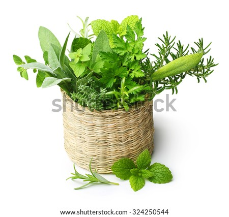 Fresh spices herbs in straw basket isolated on white background - stock photo