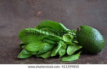 Fresh spinach, avocado and  carrots are on the dark background. Diet and healthy food.  Products for weight loss, - stock photo
