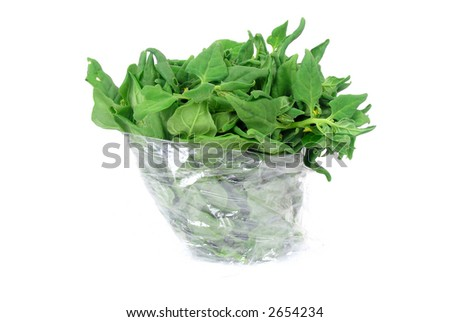 Fresh Spinach leaves bunch over white background