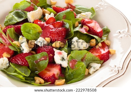 Fresh spinach salad with peanuts and blue cheese.