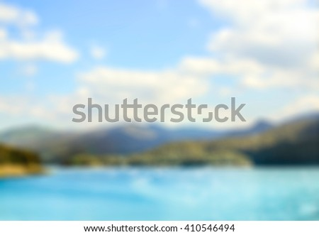 Fresh Spring and Summer in sunny day at the natural lake and mountain with beautiful sky. Panning motion style , blurred travel background. Creative ways to use for your several project design. - stock photo