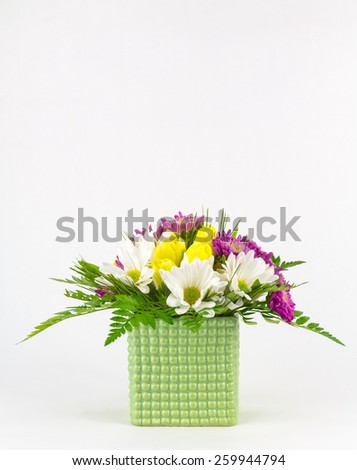 Fresh spring bouquet in glass vase in portrait orientation with copy space. - stock photo