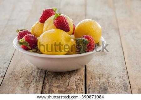 fresh spring lemon and strawberry close up - stock photo