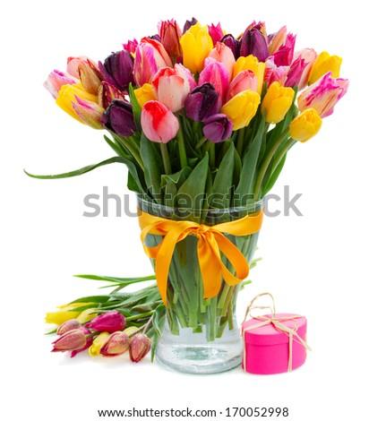 fresh spring multicolored  tulips  in vase  isolated on white background - stock photo