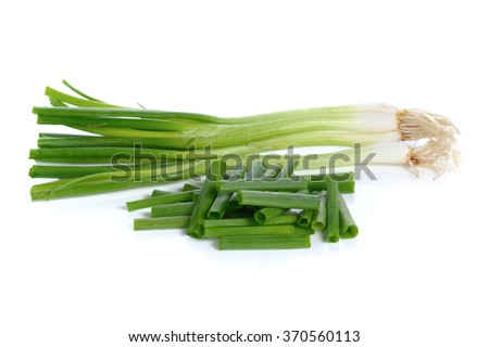 fresh spring onions isolated on a white background