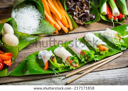 Fresh spring rolls wrapped in rice paper - stock photo