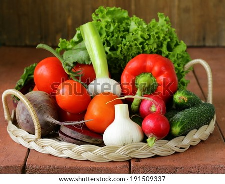 fresh spring vegetables - tomatoes, peppers, garlic, radishes, beets