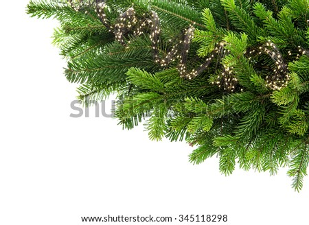 Fresh spruce sprigs with lights decoration isolated on white background. Border from green christmas tree branch - stock photo