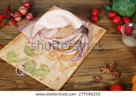 Fresh squid and spicy vegetables before cooking - stock photo