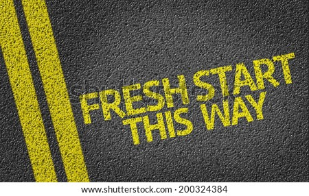 Fresh Start, This Way written on the road - stock photo