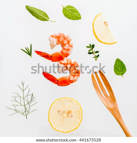 Fresh steamed shrimp isolate on white background. Boiled prawns with ingredients. Boiled prawns with herbs Fennel ,parsley,rosemary,lemon and mint with fork isolate on white background. - stock photo