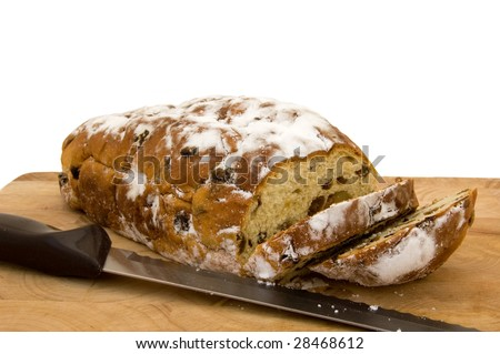 Fresh stollen bread on a wooden chopping board
