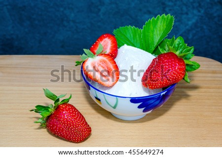 Fresh strawberries and cottage cheese on wooden background. Summer ripe strawberry - stock photo