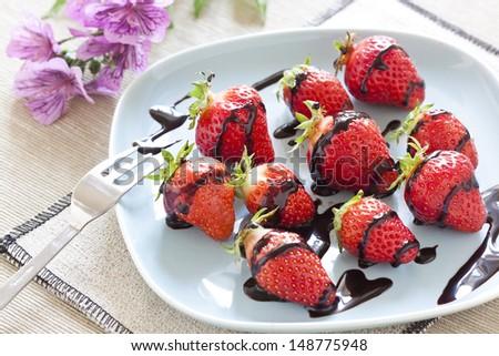 fresh strawberries and  dark chocolate - stock photo