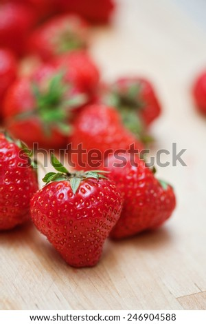 Fresh strawberries  at wooden background - stock photo