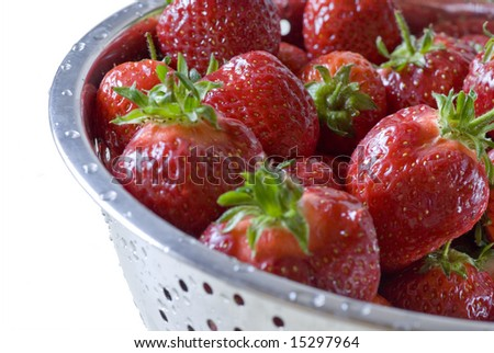 fresh strawberries in a bowl, isolated on white