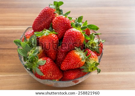 Fresh strawberries in a glass bowl.  - stock photo