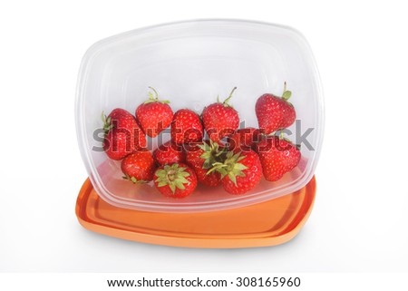 Fresh strawberries in a tupperware - stock photo